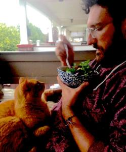 Seth with cat on porch.2